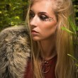 Scandinavian  girl with runic signs in a wood — Stock Photo