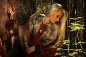 Scandinavian girl with fur skins — Stock Photo