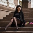 Foto de Stock  : Beautiful italiwomsitting on steps