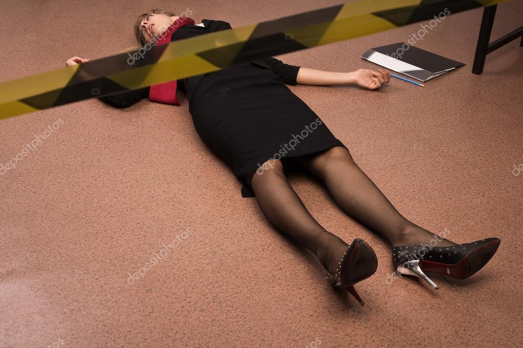 Lifeless business woman lying on the floor imitation for On the floor