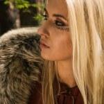Scandinavian girl with runic signs — Stock Photo
