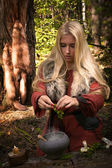 Scandinavian witch pythoness cooking potion — Stock Photo