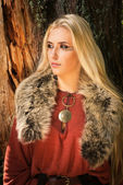 Scandinavian girl with runic signs — Stock Photo