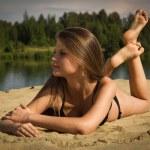 Attractive girl on a sandy beach — Stock Photo #12899937