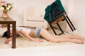 Lifeless woman lying on the floor (imitation) — Stock Photo