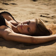 Attractive girl relaxing on a sandy beach — Stock Photo #12900112