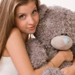 Sensuality girl with teddy-bear sitting on a sofa — Foto de Stock