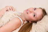 Attractive woman lying on a bed — Stock Photo
