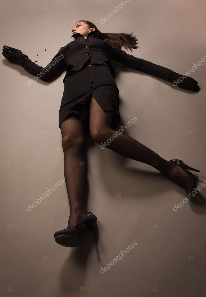 Woman In A Black Suit With Gun Lying On The Floor Stock Photo Demian 14895659