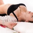 Sexual brunette lying on the bed — Stock Photo #16911137