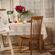 Vintage living room with old fashioned table and chair — Stock Photo
