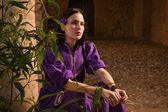 Brunette girl in a medieval suit in a Agia Napa Medieval Monaste — Stock Photo