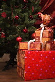 Christmas. Gifts on a fir branches background — Stok fotoğraf
