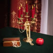 Composition with apple, candlestick and jewellery box — Stock Photo