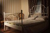 Bed in the elegant bedroom — Stock Photo