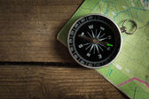 Compass on a road map — Stock Photo
