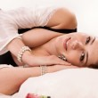 Sexual brunette lying on the bed — Stock Photo #17369583