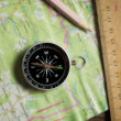 Compass, ruler and pencil on a road map — Stock Photo