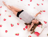 Pretty girl lying on the bed — Stock Photo