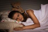 Sensual girl sleeping in the bedroom — Zdjęcie stockowe