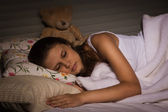Sensual girl sleeping in the bedroom — Stock fotografie