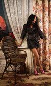 Beautiful young woman in a boudoir — Stock Photo