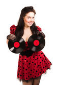 Pin-up girl with two plates — Stock Photo