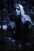 Scandinavian girl in the night forest — Stock Photo