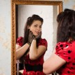 Pin-up girl in front of mirror — Stock Photo #19044977