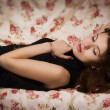 Sensual brunette lying on the sofa — Stock Photo