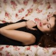Sensual brunette lying on the sofa — Stock Photo #19046421
