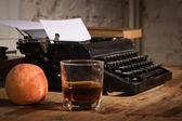 Vintage still life with typewriter — Stock Photo