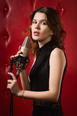 Female singer with microphone — Stock Photo
