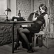 Elegant woman in black with the old typewriter — Photo