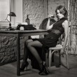 Elegant woman in black with the old typewriter — Stok fotoğraf