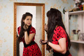 Pin-up girl in front of the mirror — Stock Photo