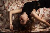 Sensual brunette lying on the sofa — Stock Photo