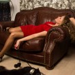 Crime scene simulation: lifeless blonde lying on the sofa — Stock Photo