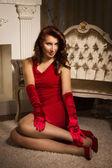 Módní lady v červených šatech — Stock fotografie