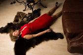 Crime scene simulation: lifeless blonde lying on the floor — Stock Photo