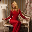 Romantic portrait of a beautiful blonde lady in a red dress — Foto Stock