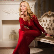 Romantic portrait of a beautiful blonde lady in a red dress — ストック写真