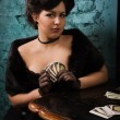 Pretty woman with cards in the vintage interior — Stock Photo