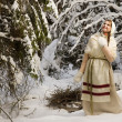 Russian beautiful girl in the winter forest — Stock Photo
