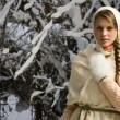 Russian beautiful girl in the winter forest — Stock Photo #22143085