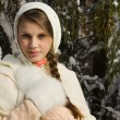 Russian beautiful girl in the winter forest — Stock Photo #22143215