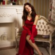 Romantic portrait of a beautiful lady in a red dress — Stock Photo