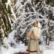 Russian girl in the winter woods — Stock Photo
