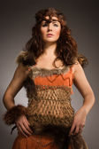 Woman in a fur suit of the amazon — Stock Photo