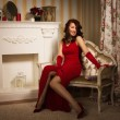 Romantic portrait of a beautiful lady in a red dress — Stock fotografie